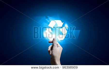 Close up of businessman touching media recycle icon