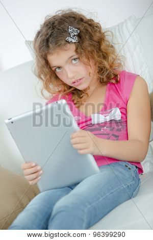 Little girl using her new tablet computer