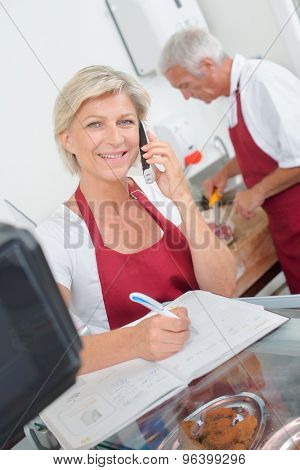Butcher couple ordering stock