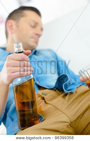 Drunk man on his sofa