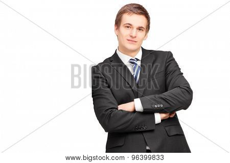 Young businessman leaning against wall isolated on white background
