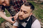pic of shaved head  - two bearded men shave outdors shave brutall - JPG