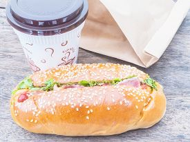 stock photo of bag-of-dog-food  - Take away cup of coffee and hot dog with paper bag - JPG