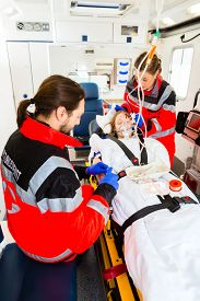 picture of accident victim  - Emergency doctor and nurse or ambulance team medicate accident victim  - JPG
