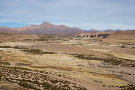 foto of open grazing area  - Large open plain created by the River Lauca in Lauca National Park - JPG