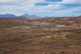 picture of open grazing area  - Large open plain created by the River Lauca in Lauca National Park - JPG