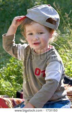 Lovely Child Plays To A Dense Grass