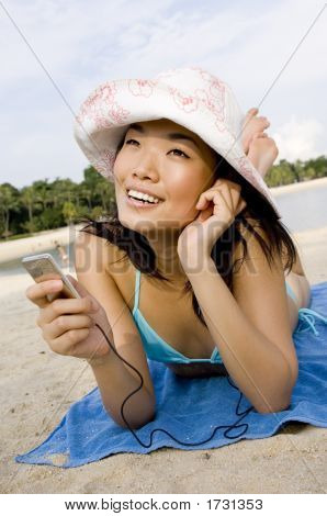 Listening To Music At Beach
