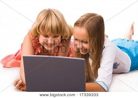two ten years old girls with laptop
