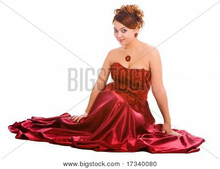 young attractive sitting woman in long red dress