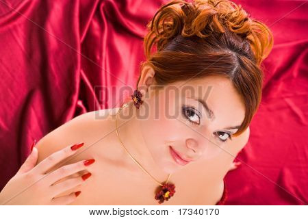 young attractive woman sitting in long red dress. view from above.