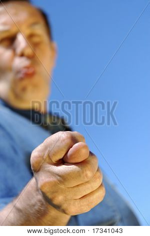 middle-aged unseriousily man showing fig with one's tongue hanging out
