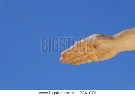 man hand in gold shine on blue background