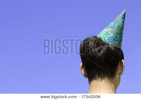 young adult with funny cap
