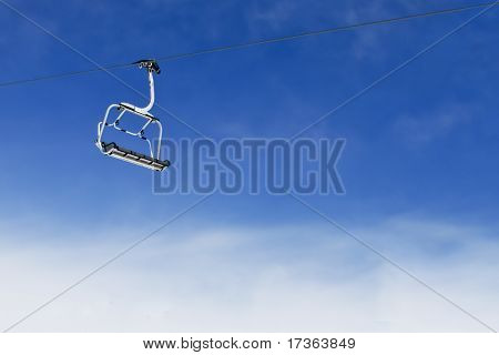 Ski Lift Chair On Bright Blue Sky