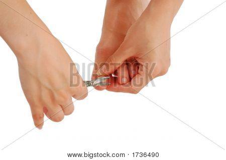 Young Woman Cutting Toenail