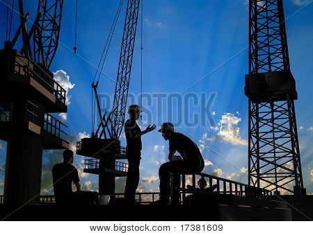The workers on a background of the sky