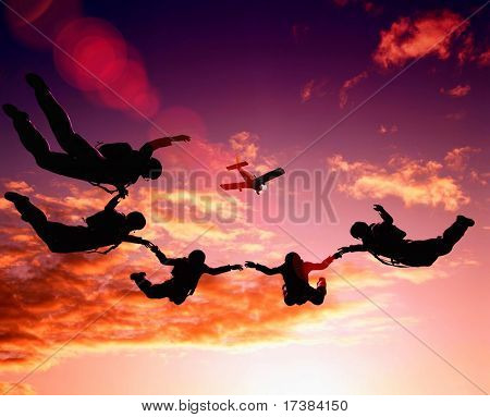 parashutist soaring in sky