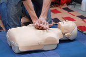stock photo of cpr  - First aid demonstration using first aid dummy - JPG