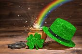 St Patricks Day Decoration With Magic Light Rainbow Pot Full Gold Coins, Horseshoe, Green Hat And Sh poster