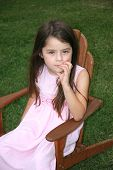 image of unnerving  - little girl with a serious look on her face - JPG