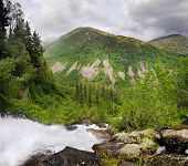 Waterfall and mountains. Double-row panorama