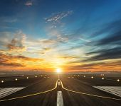airport runway in the evening sunset light, ready for airplane landing or taking off poster