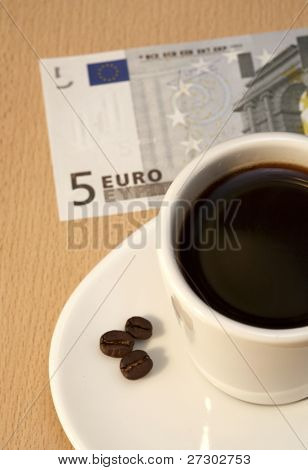 cup of coffee and five-euro note