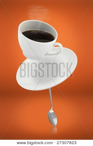 falling coffee cup with spoon and saucer