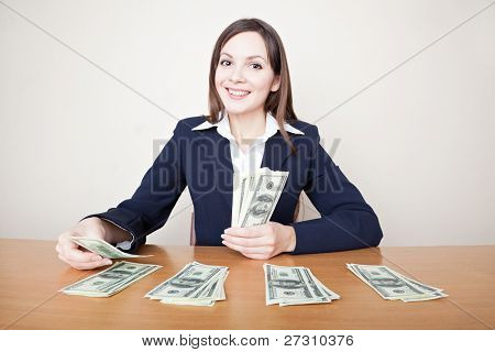 Young business woman with dollars