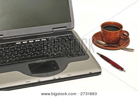 Laptop, Cup Of Coffee And Pen