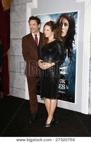 LOS ANGELES - DEC 6: Robert Downey Jr; Susan Downey at the premiere of Warner Bros. Pictures' 'Sherlock Holmes: A Game Of Shadows' at the Regency Village Theater on December 6, 2011 in Los Angeles, CA