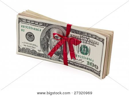 Red bow on a stack of one hundred dollar bills. Isolated white background.