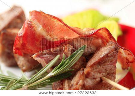 Pork shish kebab and rasher of bacon