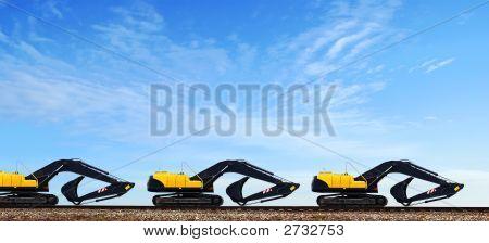 Power-Shovels On Rails.