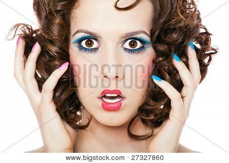 Isolated portrait shot of a beautiful woman. Holding her face in astonishment.