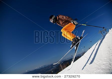 Skier girl jumping over blue sky