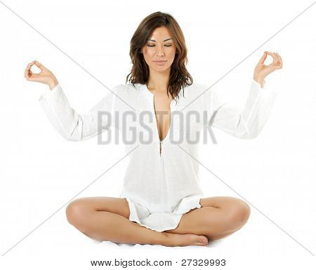 A young asian woman meditates with her eyes closed