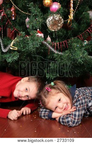 Two Children Under Christmas Tree