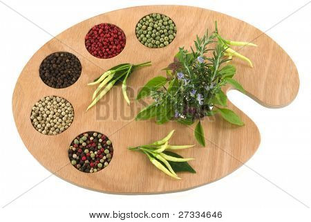 Spice and herb palette ready for the master chef to create new culinary delights. (variety of peppercorns and herbs on artist's palette)