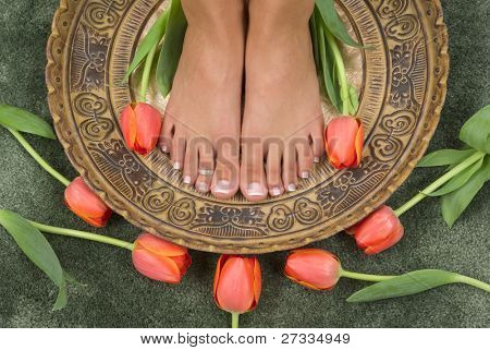 Spa treatment with beautiful elegant tulips