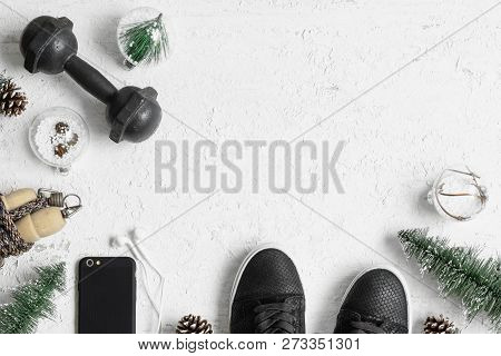 poster of Fitness And Healthy Christmas Sport Composition. Overhead Shot Of Sport Shoes, Dumbbells, Skipping R