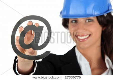 Female architect holding at symbol