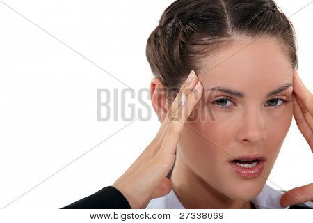 angry woman having a headache
