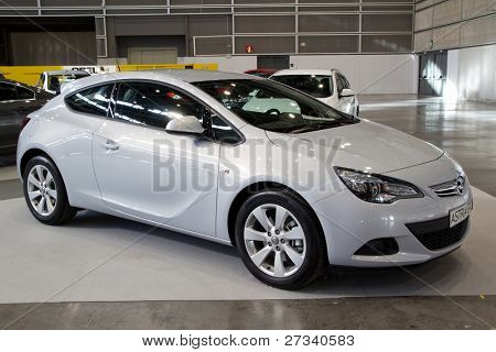 VALENCIA, SPAIN - DECEMBER 5: A 2012 Opel Astra GTC on display at the 2011 Valencia Car Show on December 5, 2011 in Valencia, Spain.