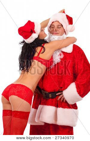 Portrait of female Santa in openwork red lingerie, which holding Santa Claus. Isolated on white.