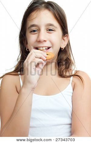 Beautiful latin girl eating homemade chocolate chips cookies isolated on white