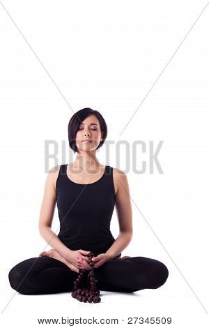 happy woman sit in yoga meditation pose with beads