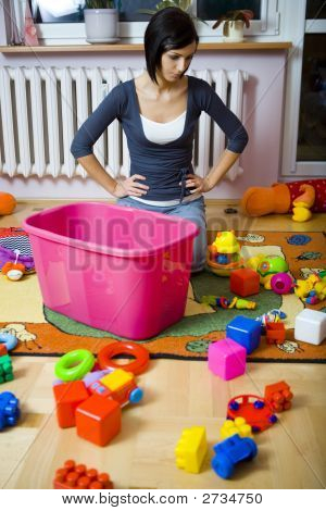Mom Stuck Cleaning Up Baby Toys