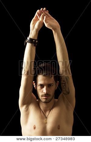 Youngo Man Posing Naked Holding Raised Hands And Arms Up